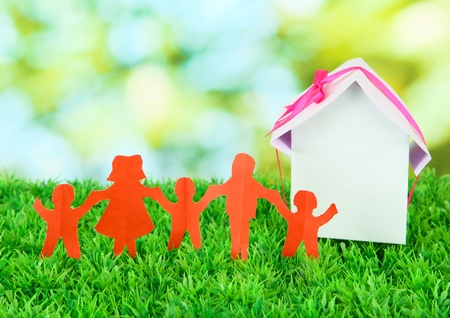 Paper people on green grass on bright background Stock Photo - 17188840