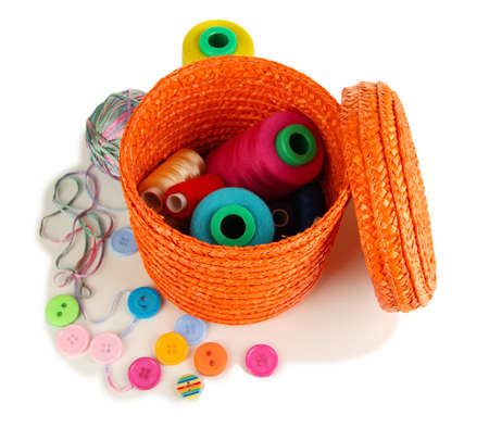 Orange wicker basket with accessories for needlework isolated on white Stock Photo - 17185890