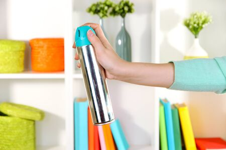 Sprayed air in hand on white shelves background Stock Photo - 17186641