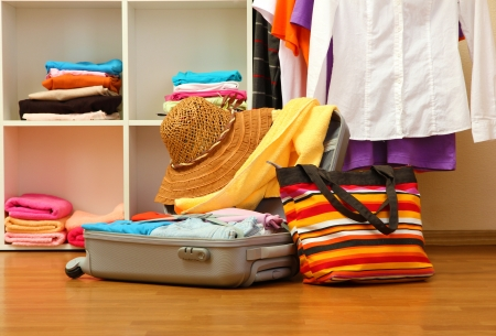 Open silver suitcase with clothing in room Stock Photo - 17189065