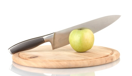 Green apple and knife on cutting board, isolated on white Stock Photo - 17183695