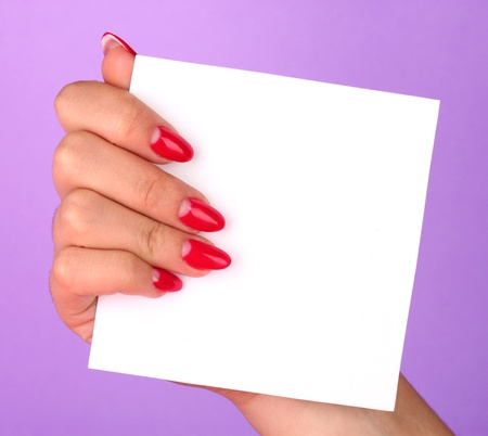 woman's hand holding blank card on color background Stock Photo - 17216874