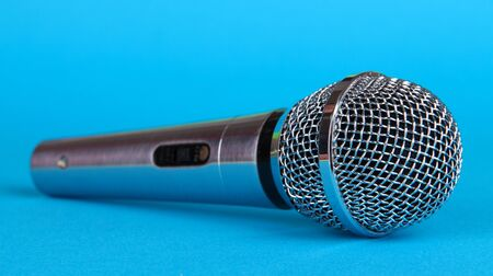 electronic voting: Silver microphone on blue background
