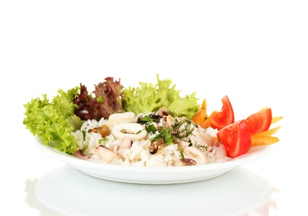 Delicatessen seafood salad with rice isolated on white photo