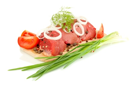 microelements: Raw beef meat marinated with herbs and spices isolated on white