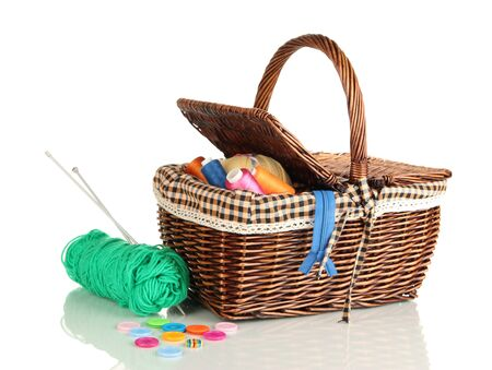 Wicker basket with accessories for needlework isolated on white Stock Photo - 17217082