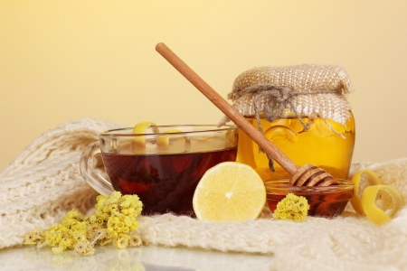 convalesce: Healthy ingredients for strengthening immunity on warm scarf on yellow background Stock Photo