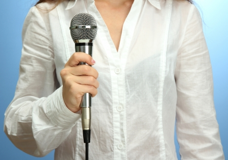 female with microphone, close up photo
