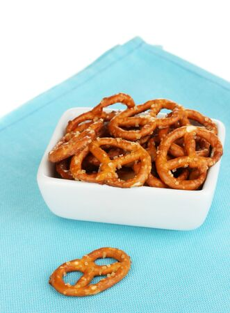 Tasty pretzels in white bowl isolated on white Stock Photo - 17245936