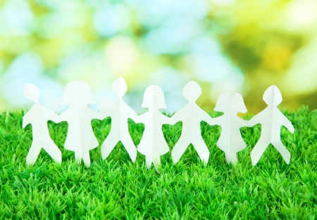 Paper people on green grass on bright background Stock Photo - 17245971