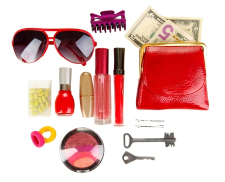 Items contained in the women's handbag isolated on white Stock Photo - 17245639