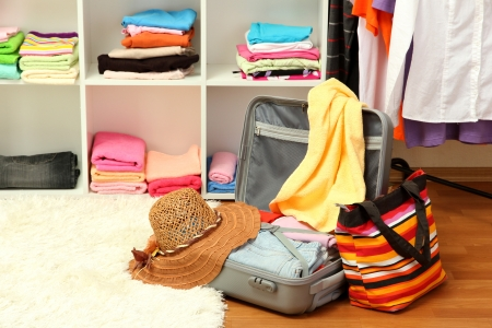 Open silver suitcase with clothing in room Stock Photo - 17246041