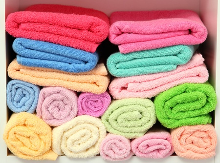colorful towels on shelves in bathroom Stock Photo - 17246064