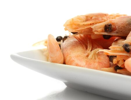 Boiled shrimps on plate, isolated on white photo