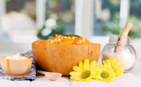 Useful pumpkin porridge in pumpkin on wooden table on window background Stock Photo - 17264488