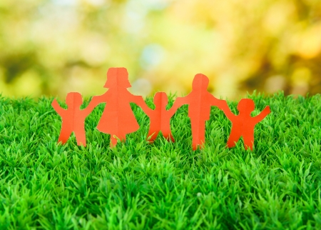Paper people on green grass on bright background Stock Photo - 17264527