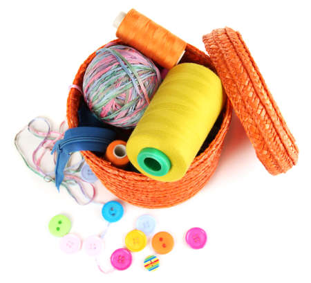 Orange wicker basket with accessories for needlework isolated on white Stock Photo - 17264373