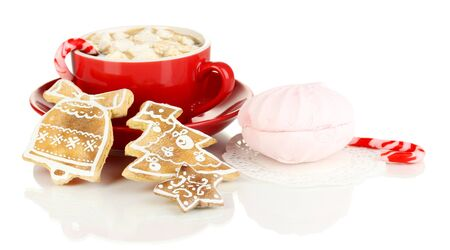 Cup of coffee with Christmas sweetness isolated on white photo