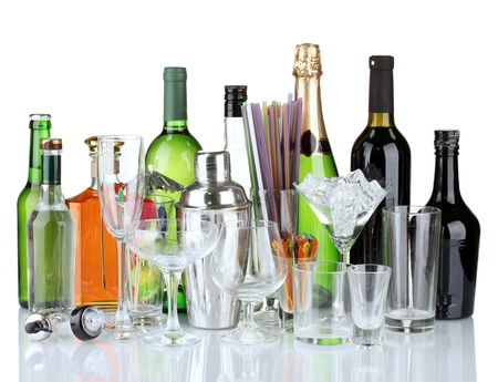 Collection of various glasses and drinks isolated on white photo
