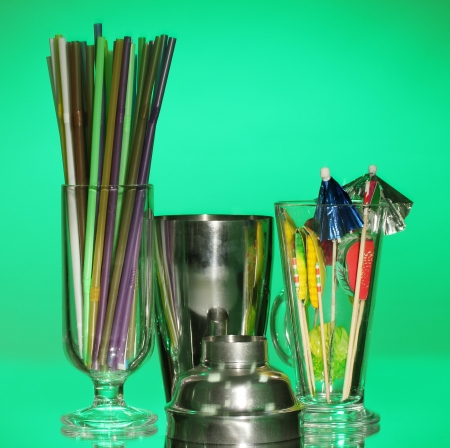Cocktail shaker and  other bartender equipment on color background photo