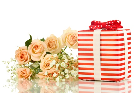 Giftbox and flowers isolated on white photo