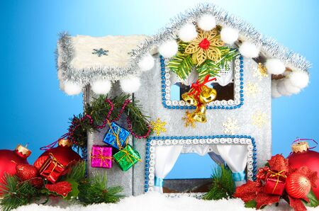 Decorated Christmas house on blue background Stock Photo - 17265881