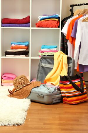 Open silver suitcase with clothing in room Stock Photo - 17265776