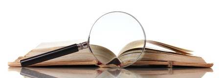 Magnifying glass and book isolated on white Stock Photo - 17264620