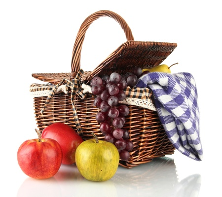 Picnic basket with fruits and blanket isolated on white Stock Photo - 17265226