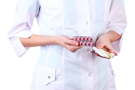 Close-up of female doctor hand holding pills, isolated on white Stock Photo - 17265374