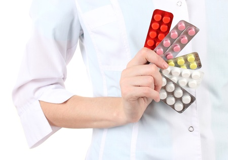 Close-up of female doctor hand holding pills, isolated on white Stock Photo - 17265269