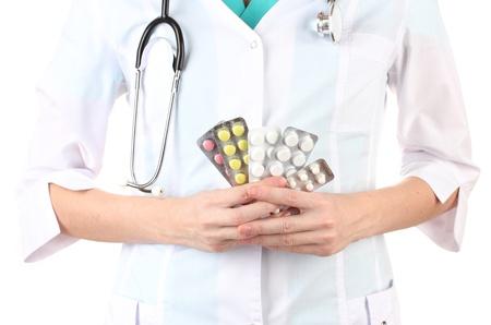 Close-up of female doctor hand holding pills, isolated on white Stock Photo - 17265170
