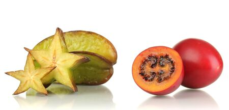 Ripe tamarillo and carambola isolated on white photo