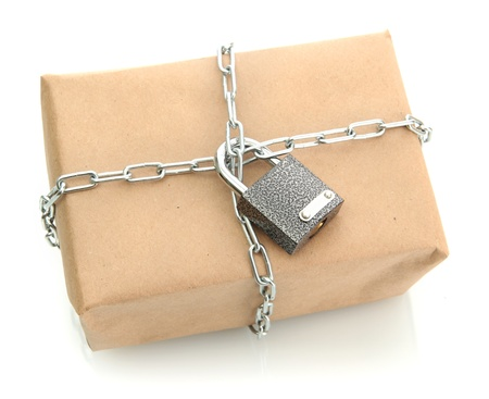 parcel with chain and padlock, isolated on white photo