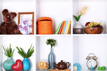 Beautiful white shelves with different home related objects Stock Photo - 17265850