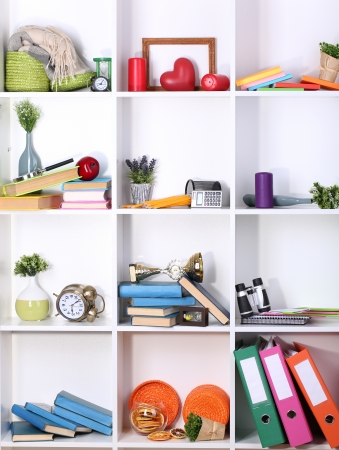 Beautiful white shelves with scattered different home related objects Stock Photo - 17265784