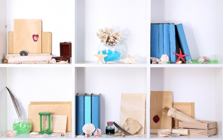 Beautiful white shelves with different travel related objects Stock Photo - 17265738