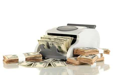 Machine for counting money and 100 dollar bills isolated on white Stock Photo - 17265276