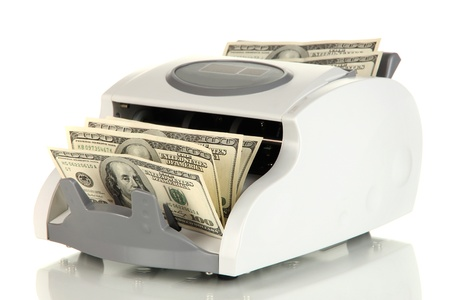 Machine for counting money and 100 dollar bills isolated on white Stock Photo - 17265274