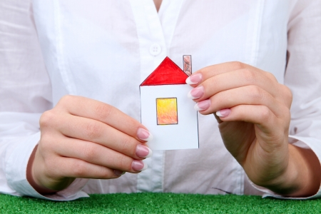 concept: woman hands with paper house, close up Stock Photo - 17321626