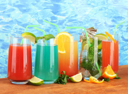 Different kinds of cocktails on blue background Stock Photo - 17321639