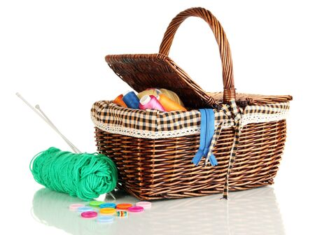 Wicker basket with accessories for needlework isolated on white Stock Photo - 17321526