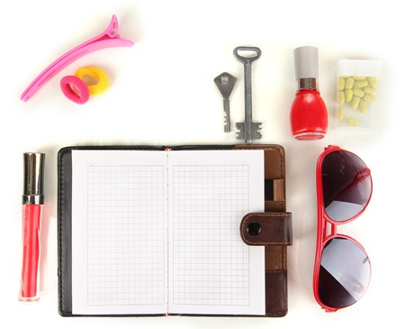 Items contained in the women's handbag isolated on white Stock Photo - 17321156