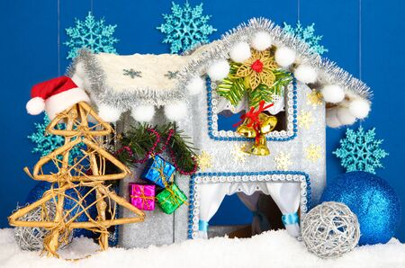 Decorated Christmas house on blue background Stock Photo - 17321829