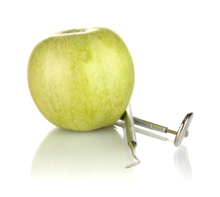 Green apple and dental tools isolated on white Stock Photo - 17321069