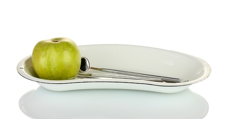 Green apple and dental tools isolated on white Stock Photo - 17321094