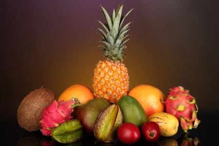 pepino: Composition of exotic fruits on colorful background