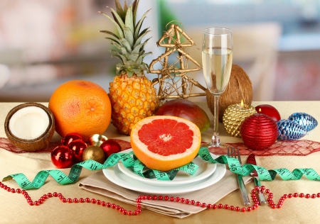 Dietary food on New Year's table on room background photo