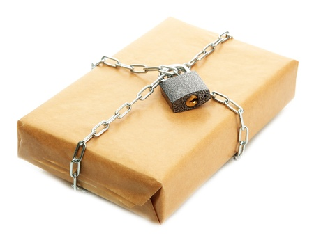 parcel with chain and padlock, isolated on white Stock Photo - 17331978