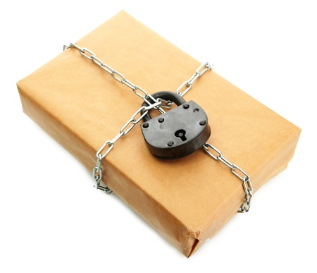 parcel with chain and padlock, isolated on white Stock Photo - 17331953